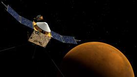 NASA robotic probe slips into orbit around Mars