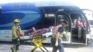 Motorist flees after hitting bus, 7 people hurt