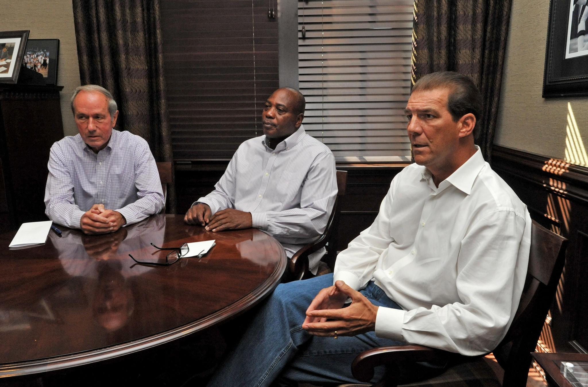 From left, Ravens president Dick Cass, general manager Ozzie Newsome, and owner Steve Bisciotti.