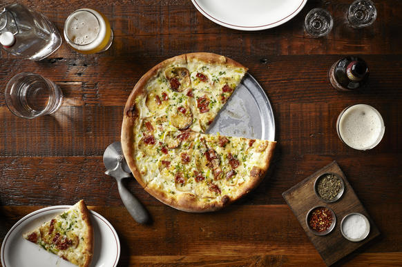 """<a href=""""http://chicago.metromix.com/venues/mmxchi-parlor-pizza-bar-venue"""">Parlor Pizza Bar</a><br> <i>108 N. Green St. 312-600-6090</i><br> <b>Rating:</b> 2.5 (out of 4)<br> <a href=""""http://www.redeyechicago.com/entertainment/restaurants-bars/redeye-parlor-pizza-bar-review-20140919-20140925,0,4594616.story"""">Read our full review here.</A>"""