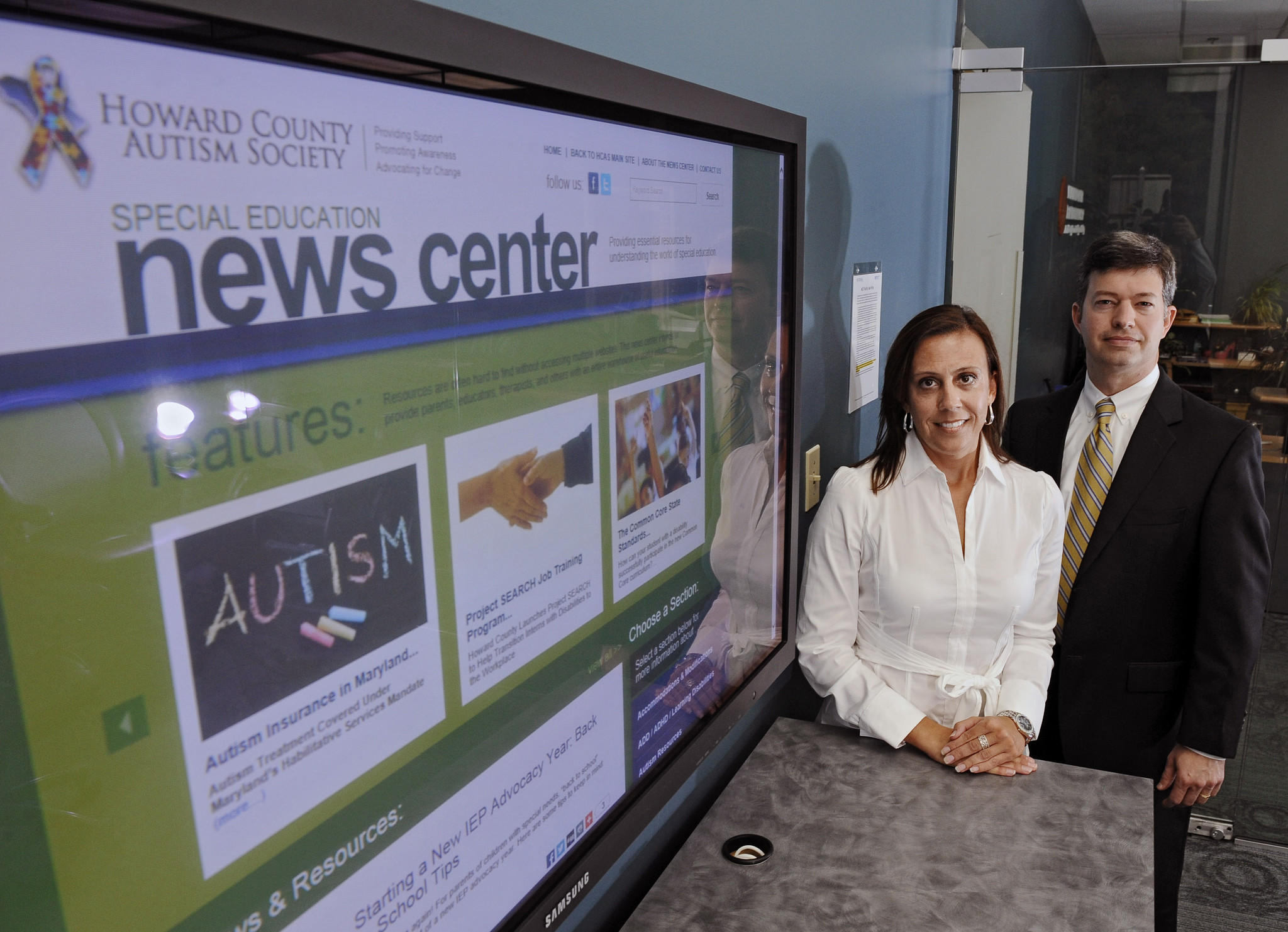 Columbia, Md.--9/25/14-- Kirk Couser, right, CEO of NextLOGIK, and Elizabeth Benevides, left, Associate Director Autism Programs at Hussman Foundation, combined to create a new website devoted to help parents of autistic children find resources and help. Both Couser and Benevides were on the board of the Howard County Autism Society when they started the project.