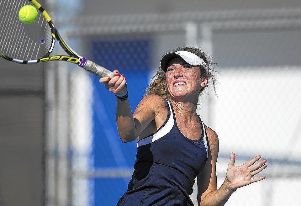Newport Harbor High's Jenn Kingsley returns a forehand during a Sunset League match against Los Alamitos on Thursday.