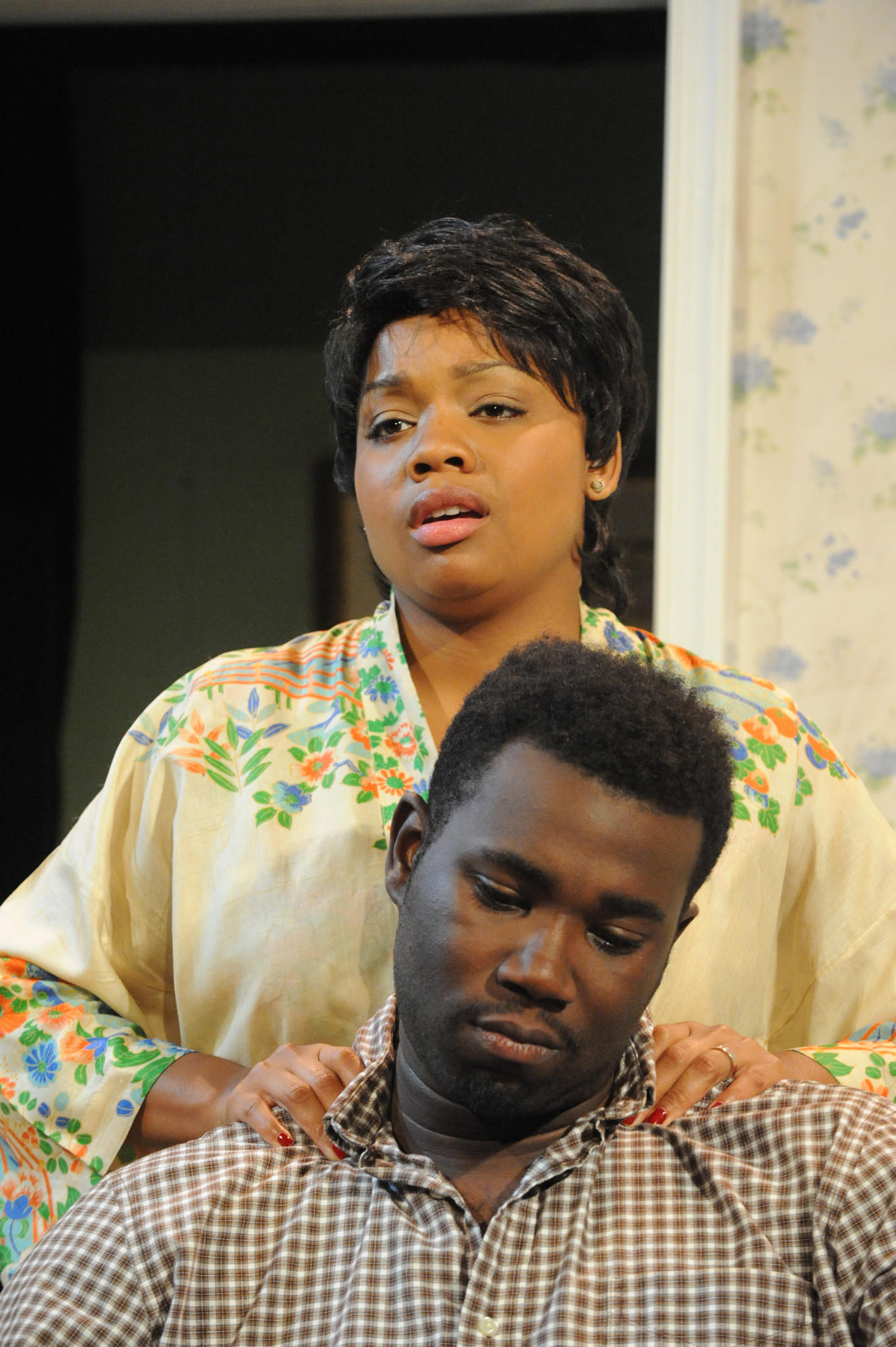 "Krenee Tolson as Ruth and Kahlil Daniel as Walter appear in ""A Raisin in the Sun,"" continuing through Oct. 19 at Compass Rose Theatre in Annapolis."