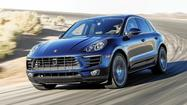 2015 Porsche Macan is a sports car in a compact crossover body