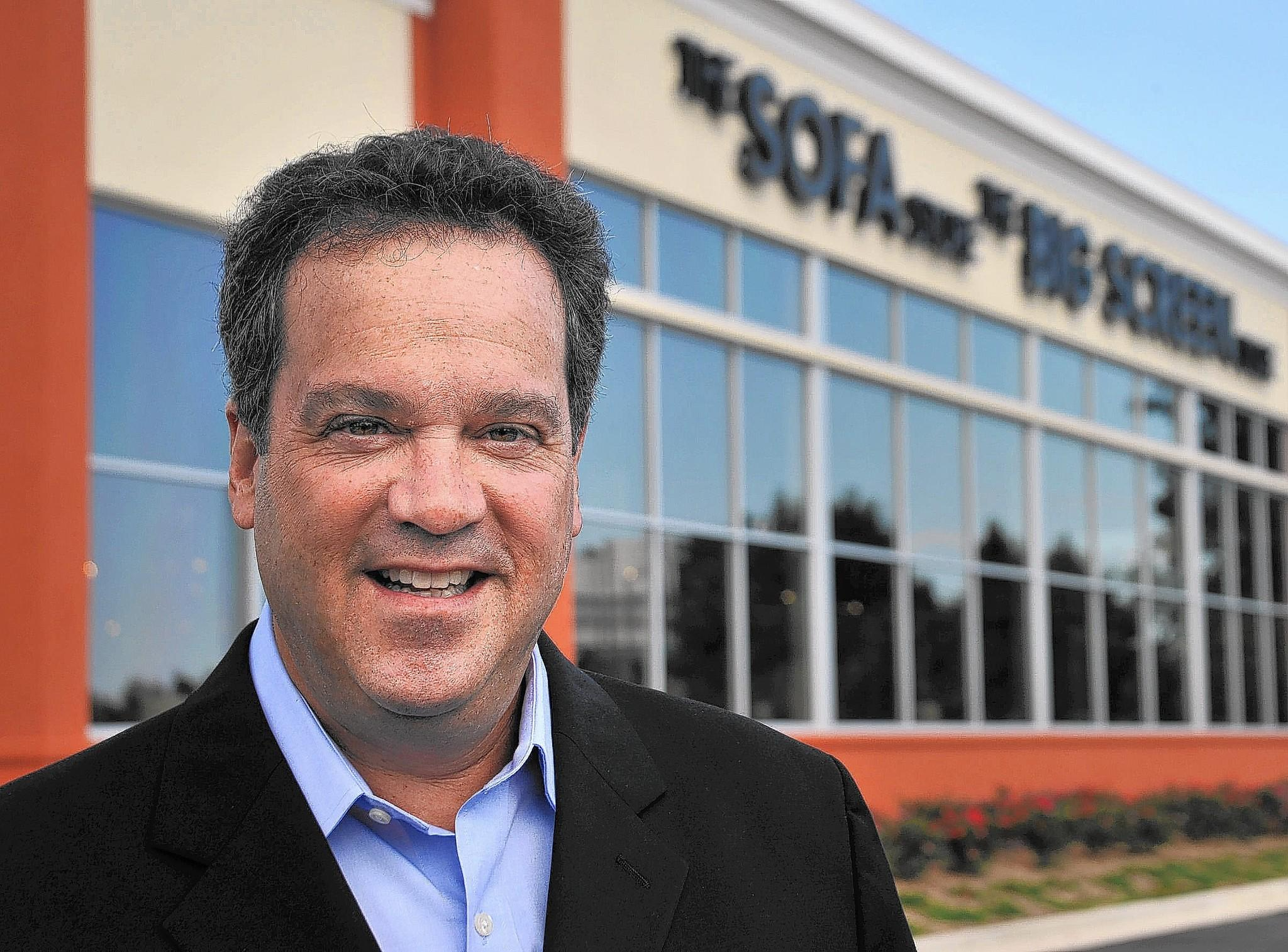 Kevin Luskin is co-owner of the new combination outlet of The Sofa Store and The Big Screen Store in Glen Burnie.