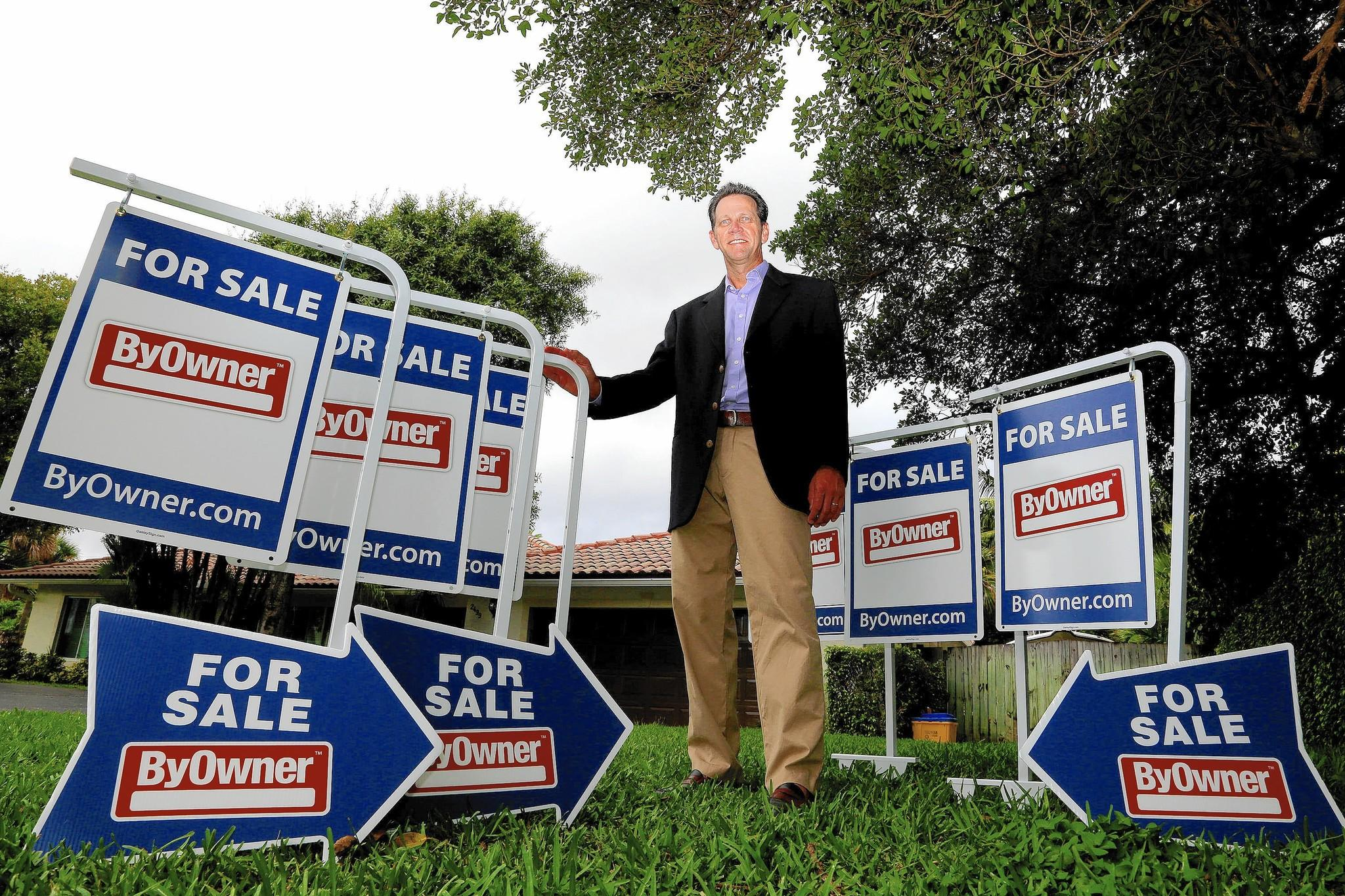 Greg Sullivan, President of ByOwner.com, is shown in the front yard of his Boca Raton home on Thursday, Sept. 25, 2014.