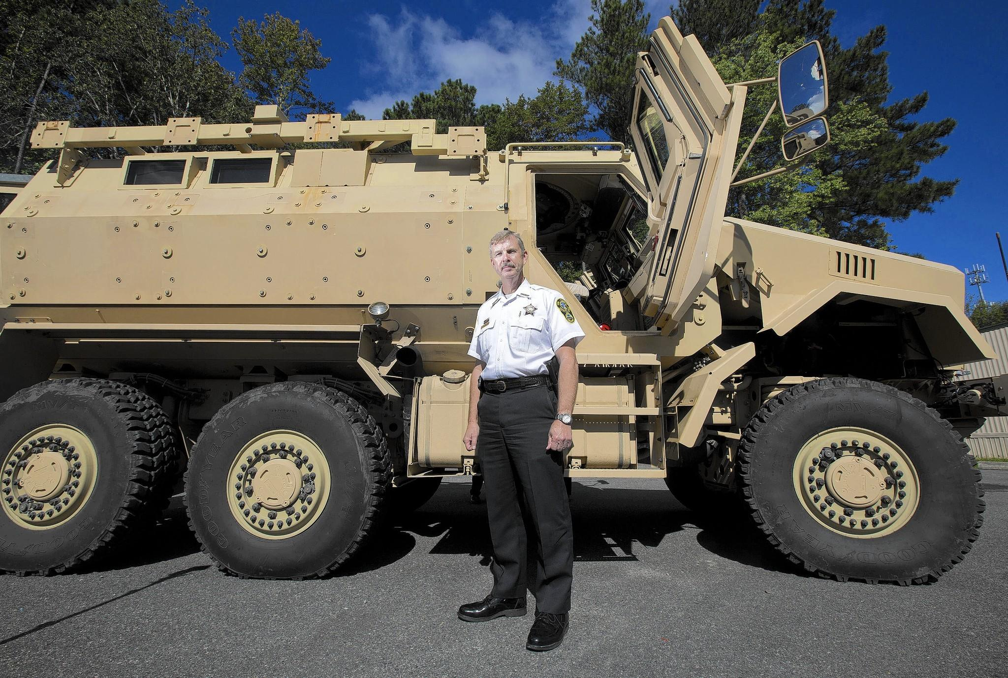 "York-Poquoson Sheriff J.D. ""Danny"" Diggs stands in front of a Mine-Resistant Ambush Protected (MRAP) vehicle that the York-Poquoson Sheriff's Office acquired in May."