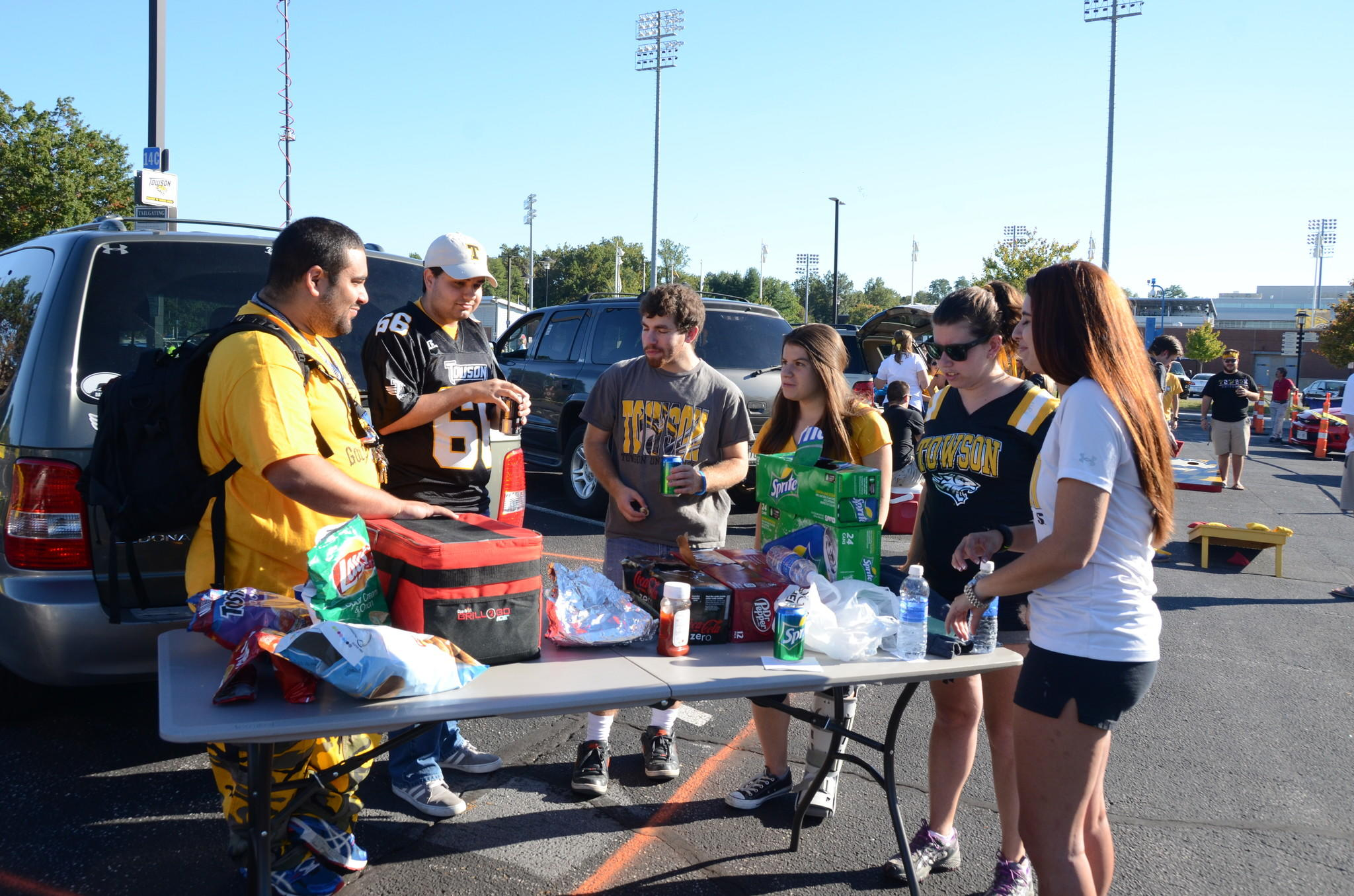 Towson University students, from left, Adam Vargas, Ben Price, Joel Wiener, Karen Cohen, Sara Millman and Rachel Sevel tailgate before Saturday night's football game against the Maine Black Bears. Fewer students tailgated before the game after the university instituted new rules, including a limit on alcohol, a ban on pickup trucks and a requirement to attend a 30-minute workshop in order to get a tailgating permit.