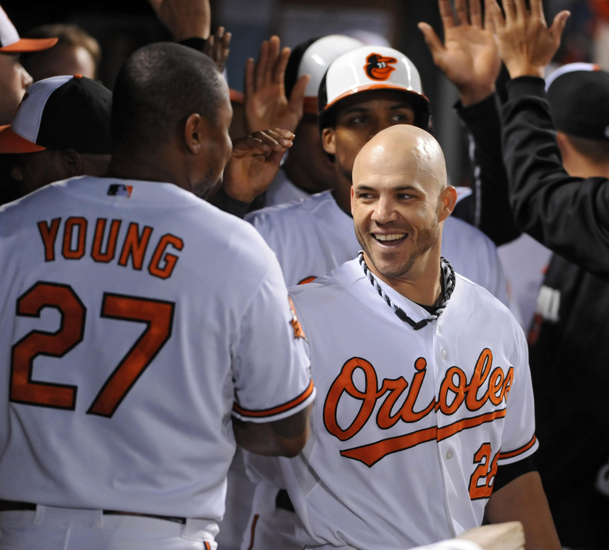 Steve Pearce, center, celebrates in the dug out after hitting a three-run home-run against the Blue Jays in the fifth inning at Oriole Park at Camden Yards.