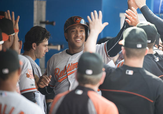 Orioles second baseman Jonathan Schoop celebrates in the dugout after hitting a solo home run in the fifth inning against the Toronto Blue Jays at Rogers Centre.