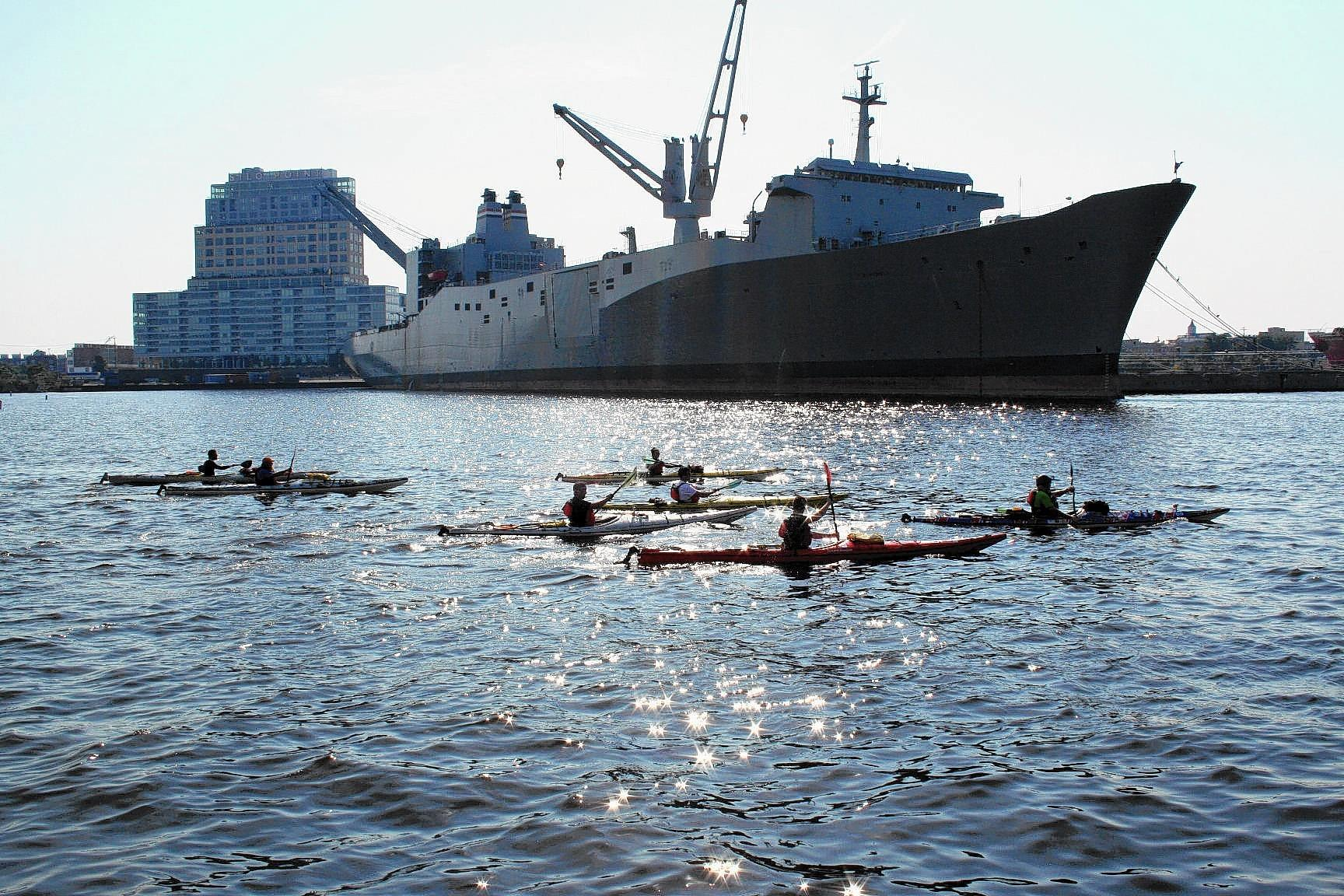 Kayakers arrive in Baltimore's harbor on Sept. 21, the final leg of a journey that had begun six days before in Ocean City.