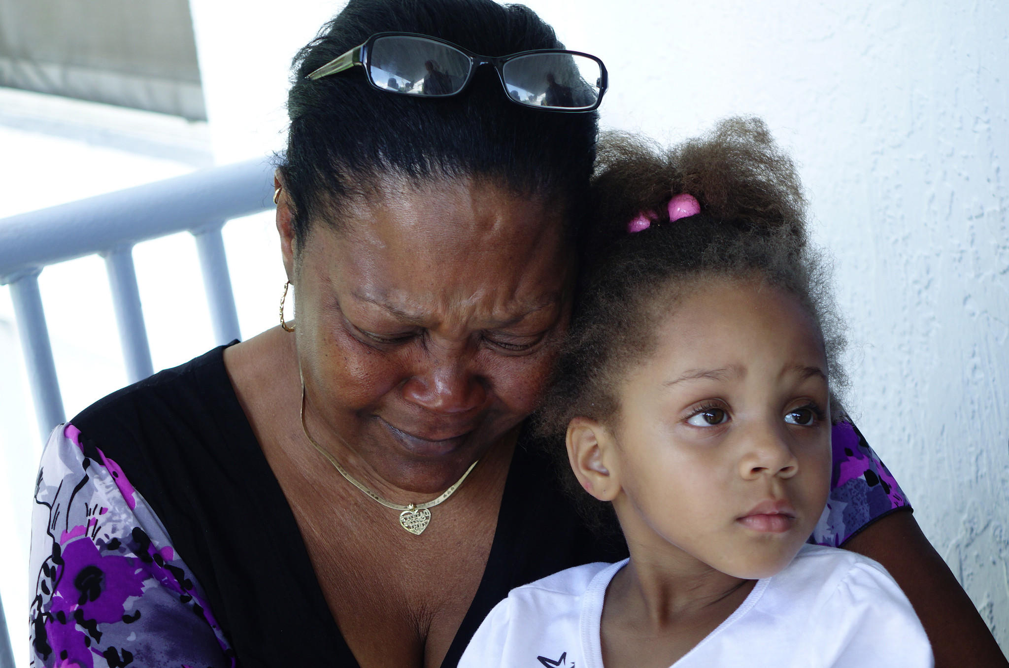Pamela Baker, mother of shooting victim Darrel Joshua Baker, 25, is seen along with his daughter Alaaliyah Baker, 4, Sunday at the family home in Hollywood.