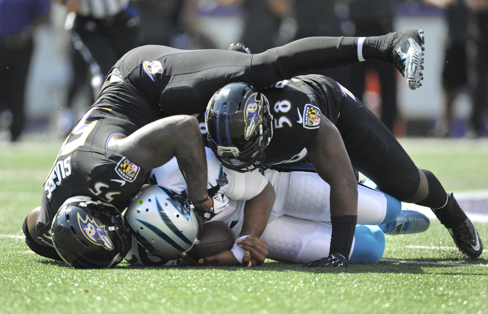 Ravens linebackers Terrell Suggs, left, and Elvis Dumervil, right, sack Carolina Panthers quarterback Cam Newton in the first quarter at M&T Bank Stadium.