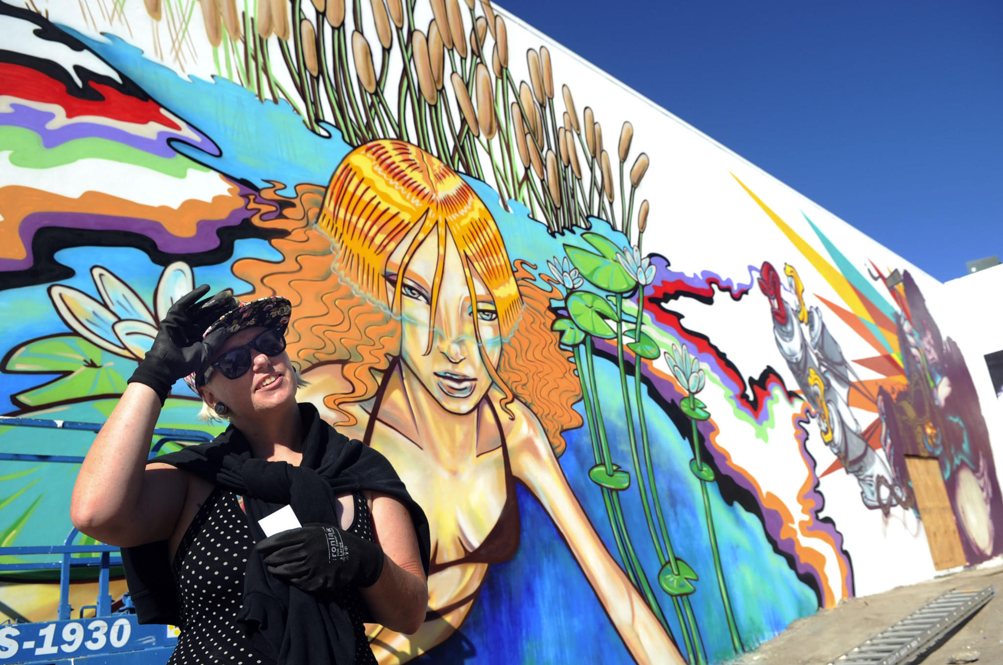 """West Palm Beach, 12/18/2013 -- Mural artist Kaz """"Kazilla"""" Williams of Miami, takes a break from painting a mural in the 500 block of Fern Street Wednesday. Mark Randall, South Florida Sun Sentinel"""