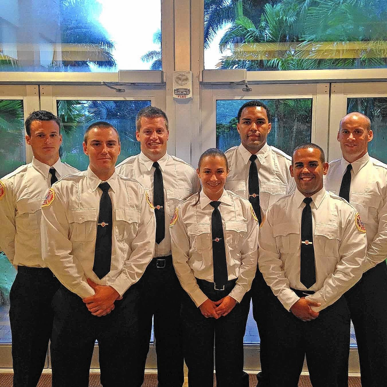 New fire-rescue recruits are, from left, Paul Britt, Erik Grau, Jacob Peterson, Tia Kyotikki, John Braswell, Ivan Flores and Matthew Strahle.