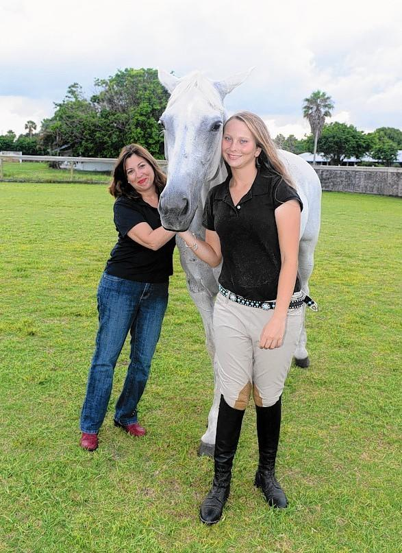 Abbi and Hannah Bentz, co-chairwomen of the Horses Helping People Family Resource Day, along therapy horse Crystal.