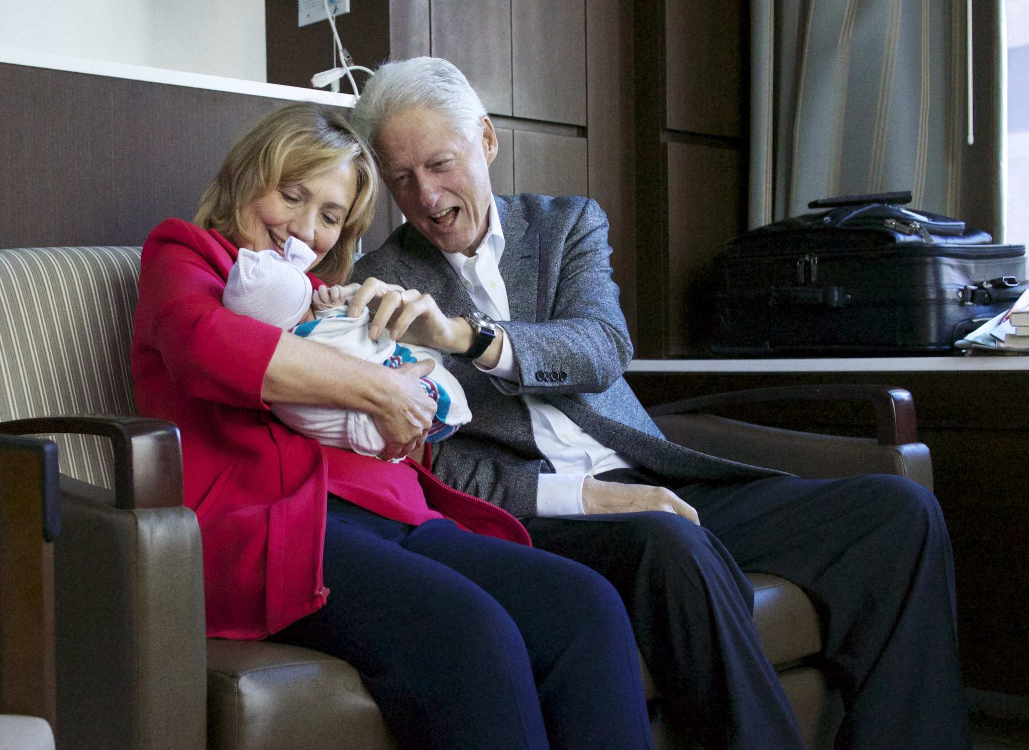 Former President Bill Clinton and his wife, former Secretary of State Hillary Clinton, hold their granddaughter Charlotte Clinton Mezvinsky after their daughter Chelsea Clinton gave birth in New York.