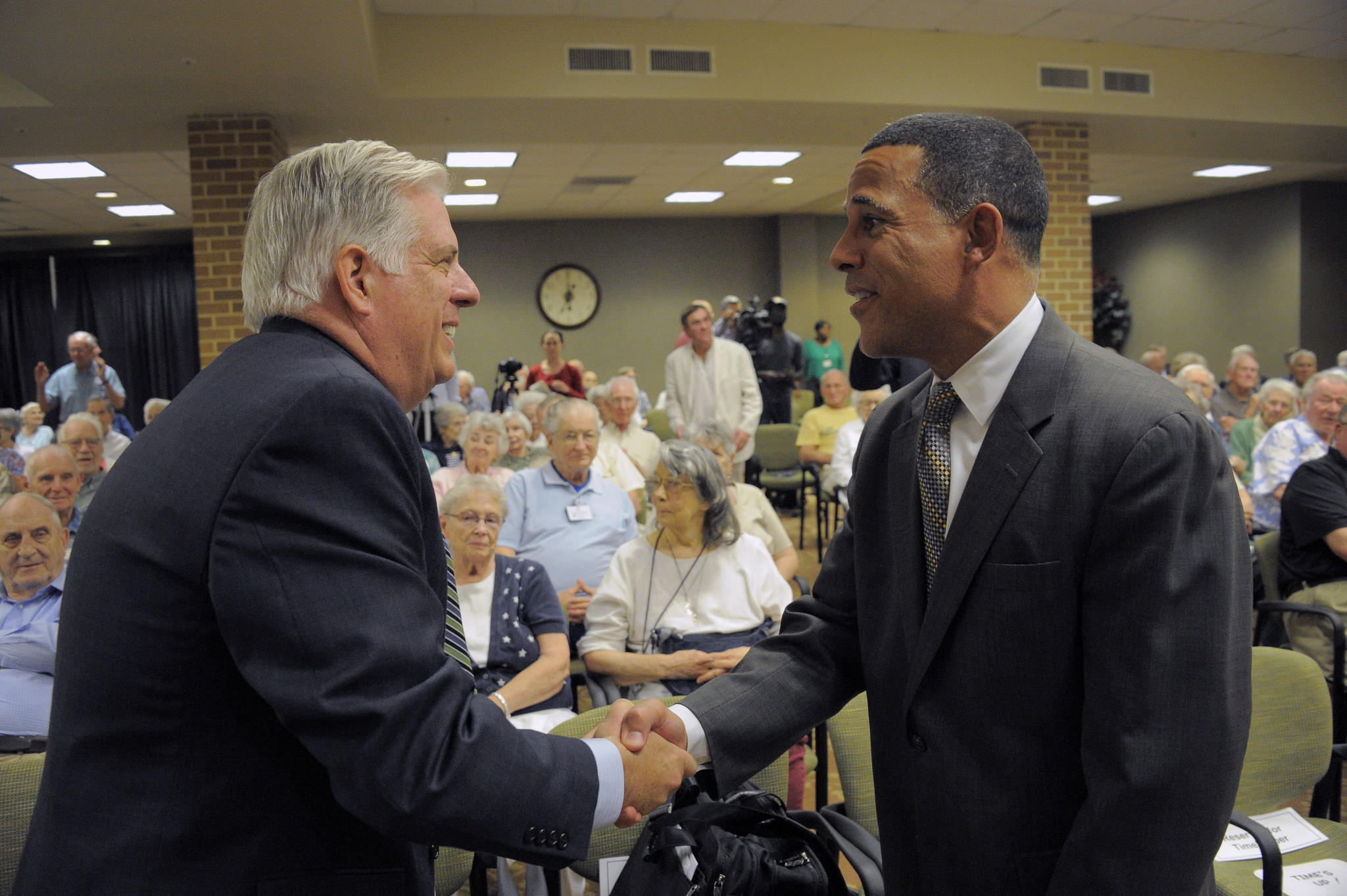 GOP candidate Larry Hogan (left) shakes hands with Lt. Gov. Anthony Brown before a gubernatorial candidate's forum at Charlestown Retirement community.