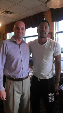The Bulls' Derrick Rose (right) at Giordano's in Oak Brook with restaurant manager Brendan Clough (left) Sept. 25, 2014.