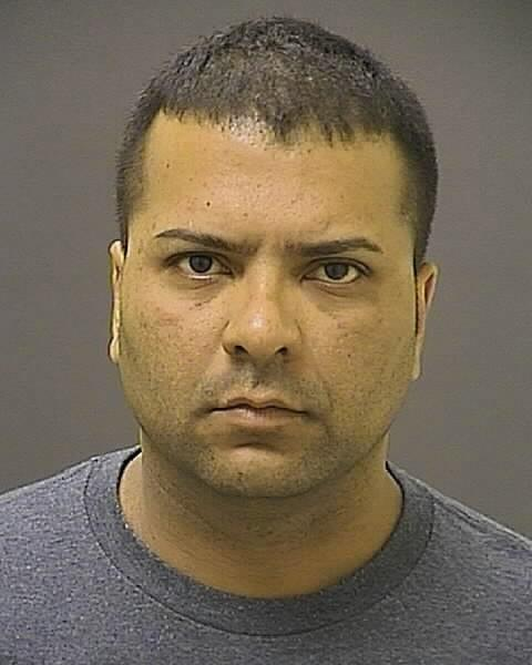 Baltimore Police Officer Gualberto Diaz, 38, was charged with assaulting his wife and her boyfriend while in uniform.