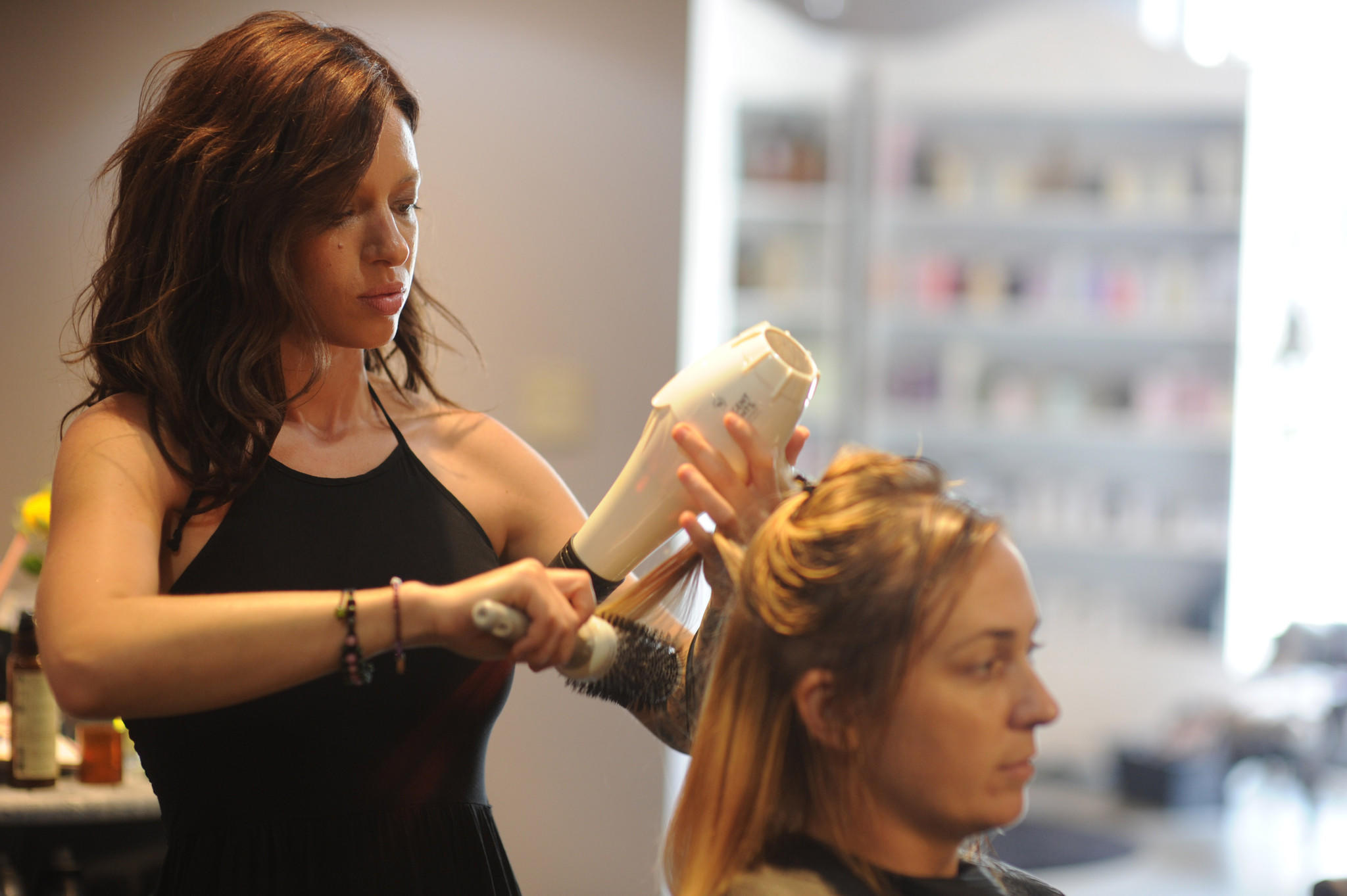 Kathleen Lauer, owner of Inspire Salon, styles the hair of Carla Jacobsen of Burtonsville. Inspire uses organic, fair trade, cruelty-free and environmentally focused hair products.