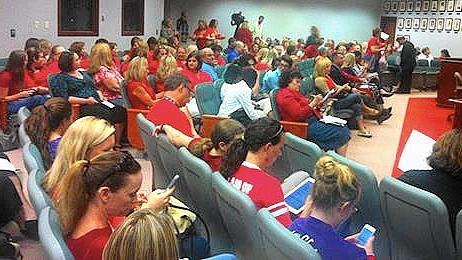 Teachers who planned to air grievances to Lake County School Board members wore red Monday night, but the meeting was canceled because of a lack of a quorom.