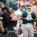 Machado, Athletics battle leads to bat toss