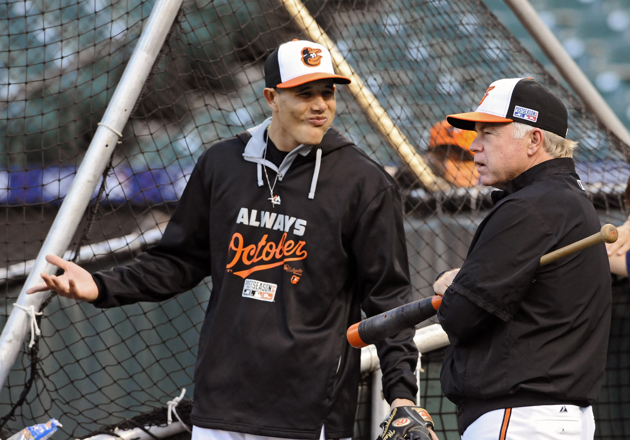 Orioles manager Buck Showalter talks with Manny Machado as the teams work out before Game 1 of the ALDS at Camden Yards.