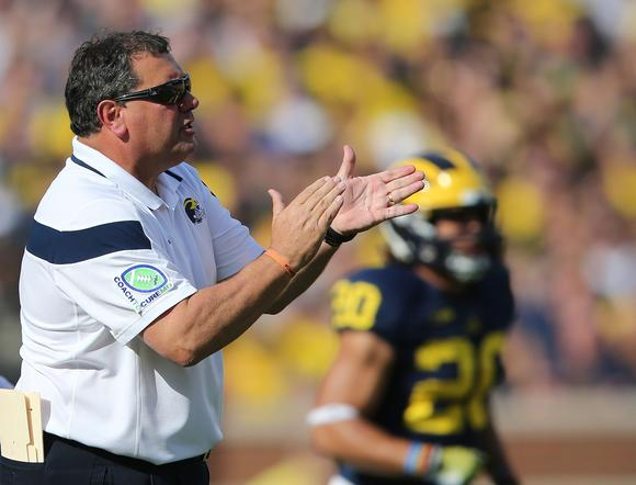 brady hoke resume michigan head coach brady hoke right reacts on