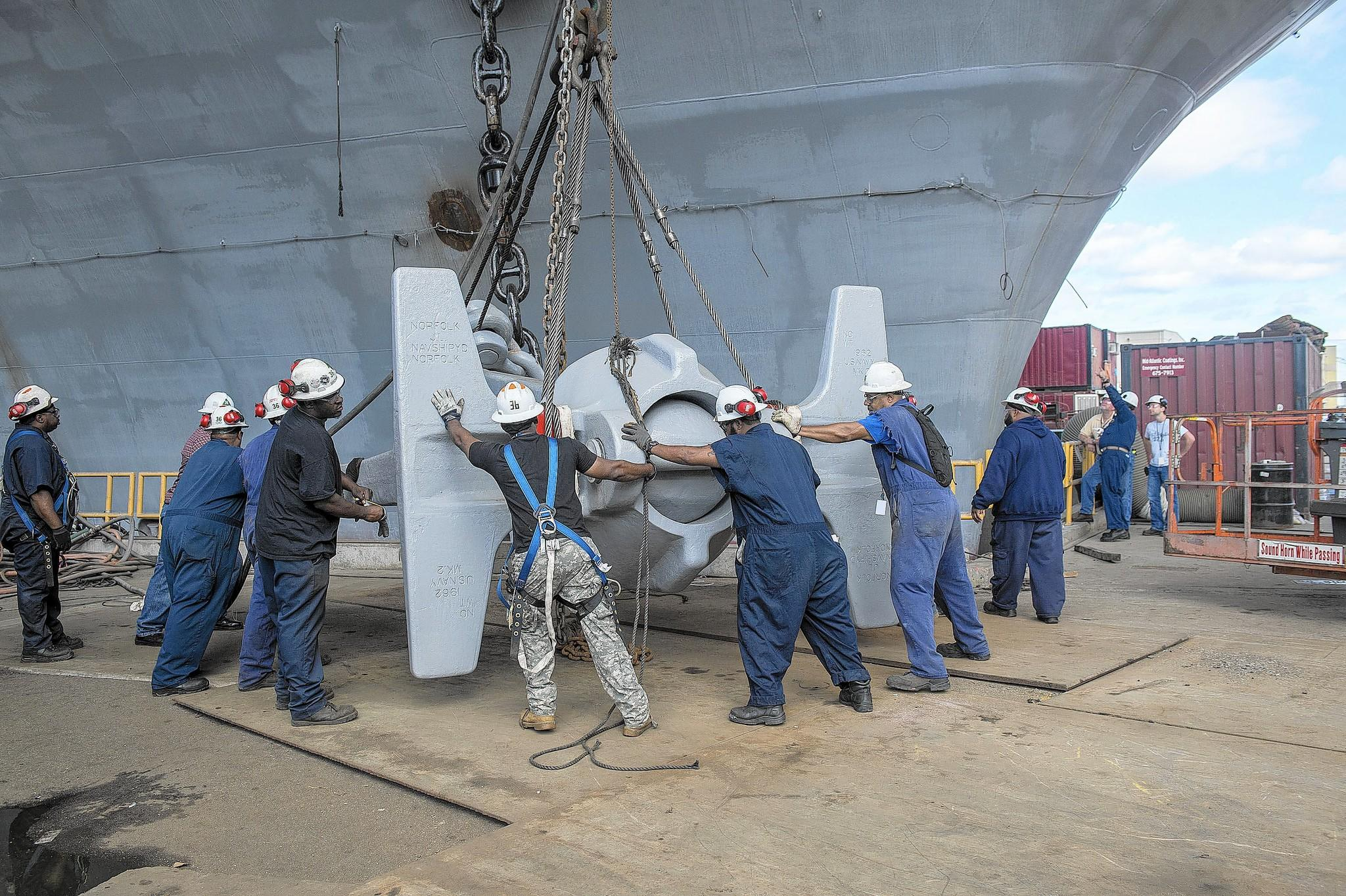 Workers at Newport News Shipbuilding recently installed an anchor on the USS Abraham Lincoln that came used, but in good condition. It was taken from the former USS Enterprise, the world's first nuclear-powered carrier, now inactivated and docked a few hundred yards away.