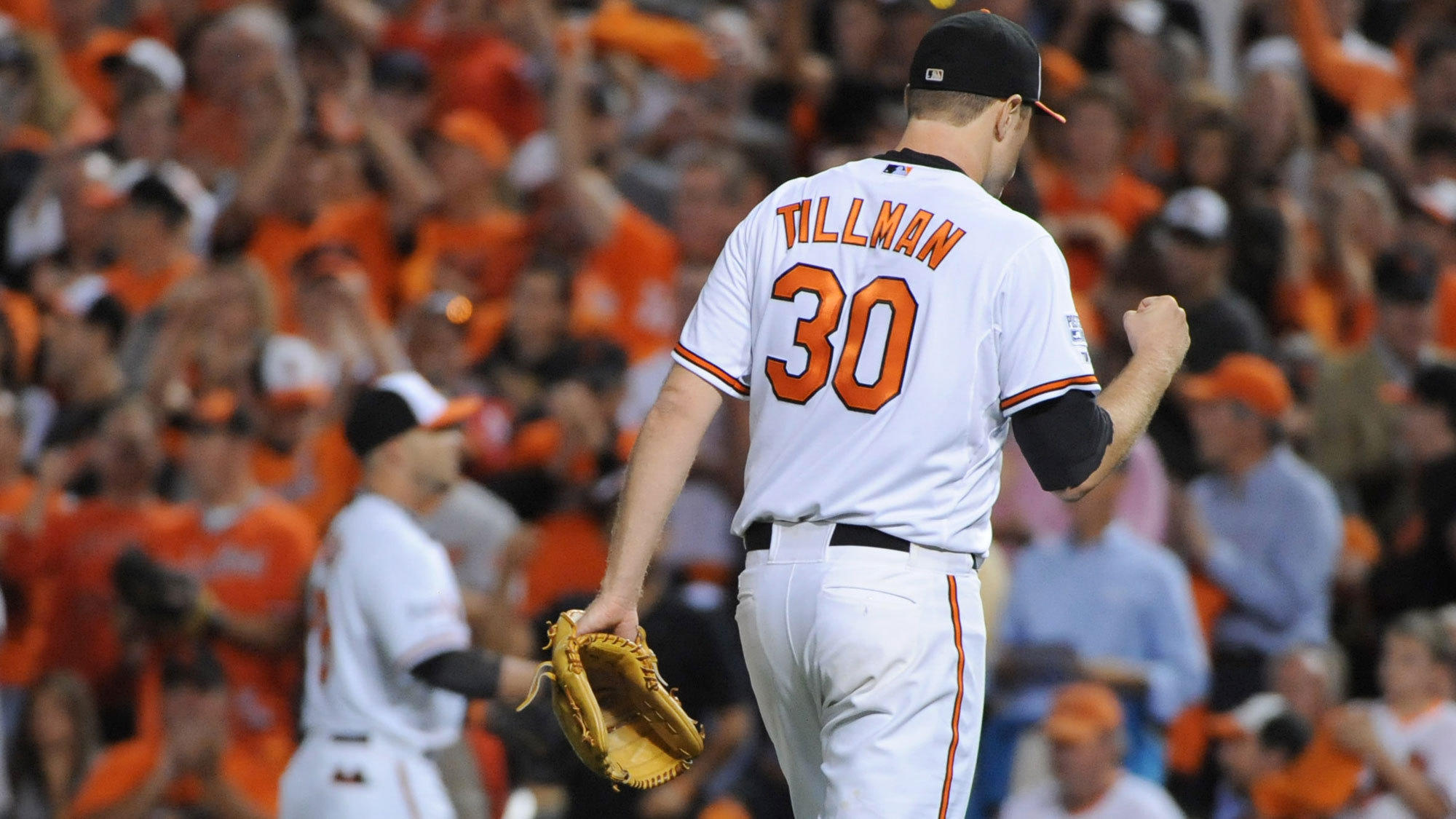 Chris Tillman celebrates getting out of the 5th inning of Game 1 of the ALDS.