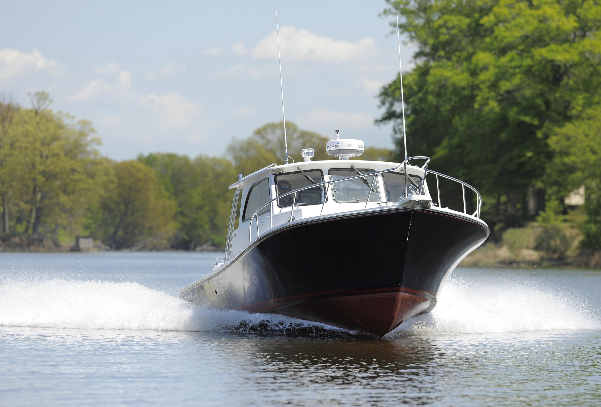 A custom built boat being driven in the Chesapeake Bay by Bill Judge, the owner of Judge Yachts in Denton.
