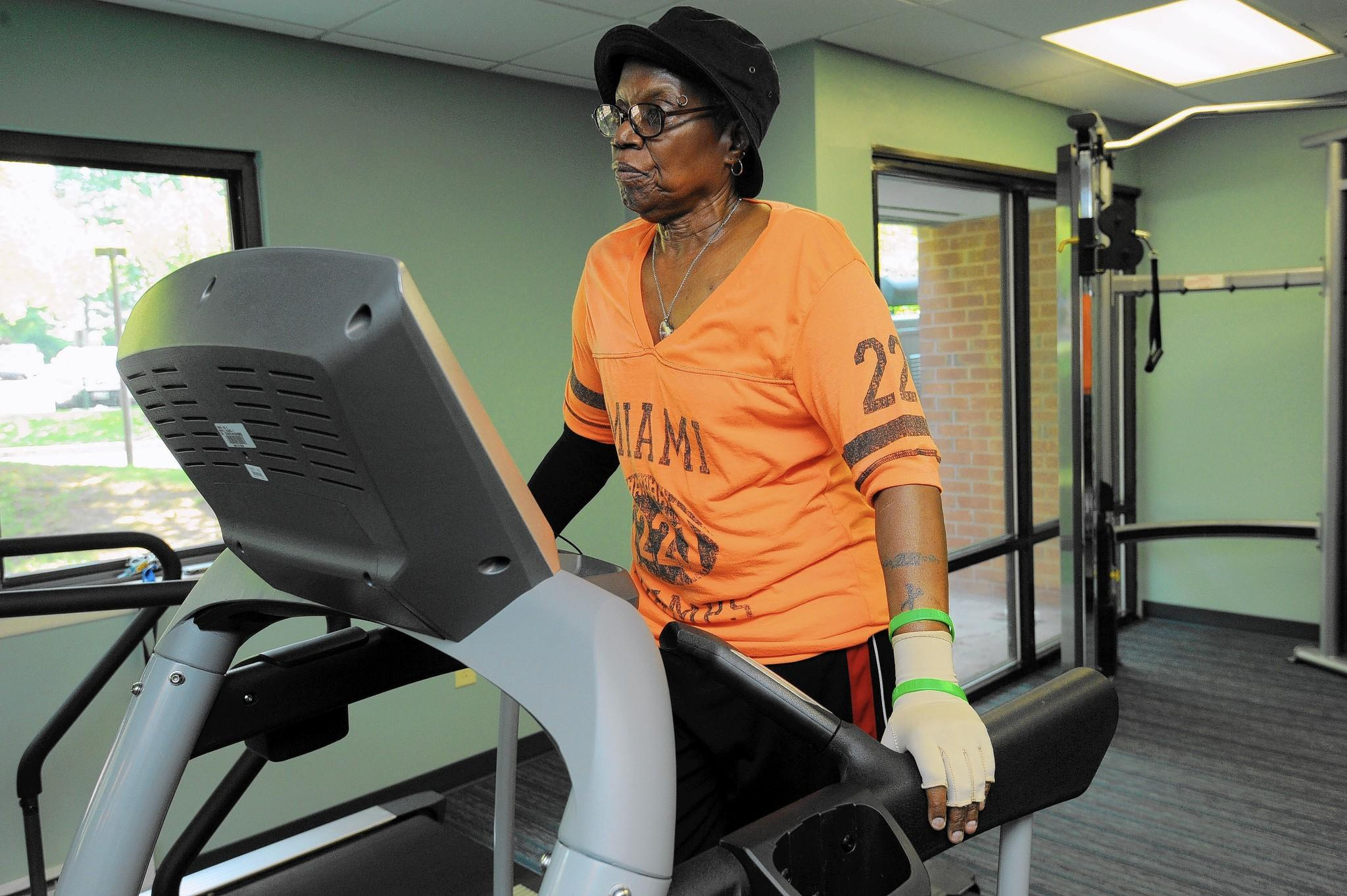 "Dianne Harrod, 65, walks on a treadmill in her building's gym. She is living with metastatic breast cance and credits her positive attitude and her diet for her survival. ""It's what you eat and what you do and don't feel sorry for yourself."""