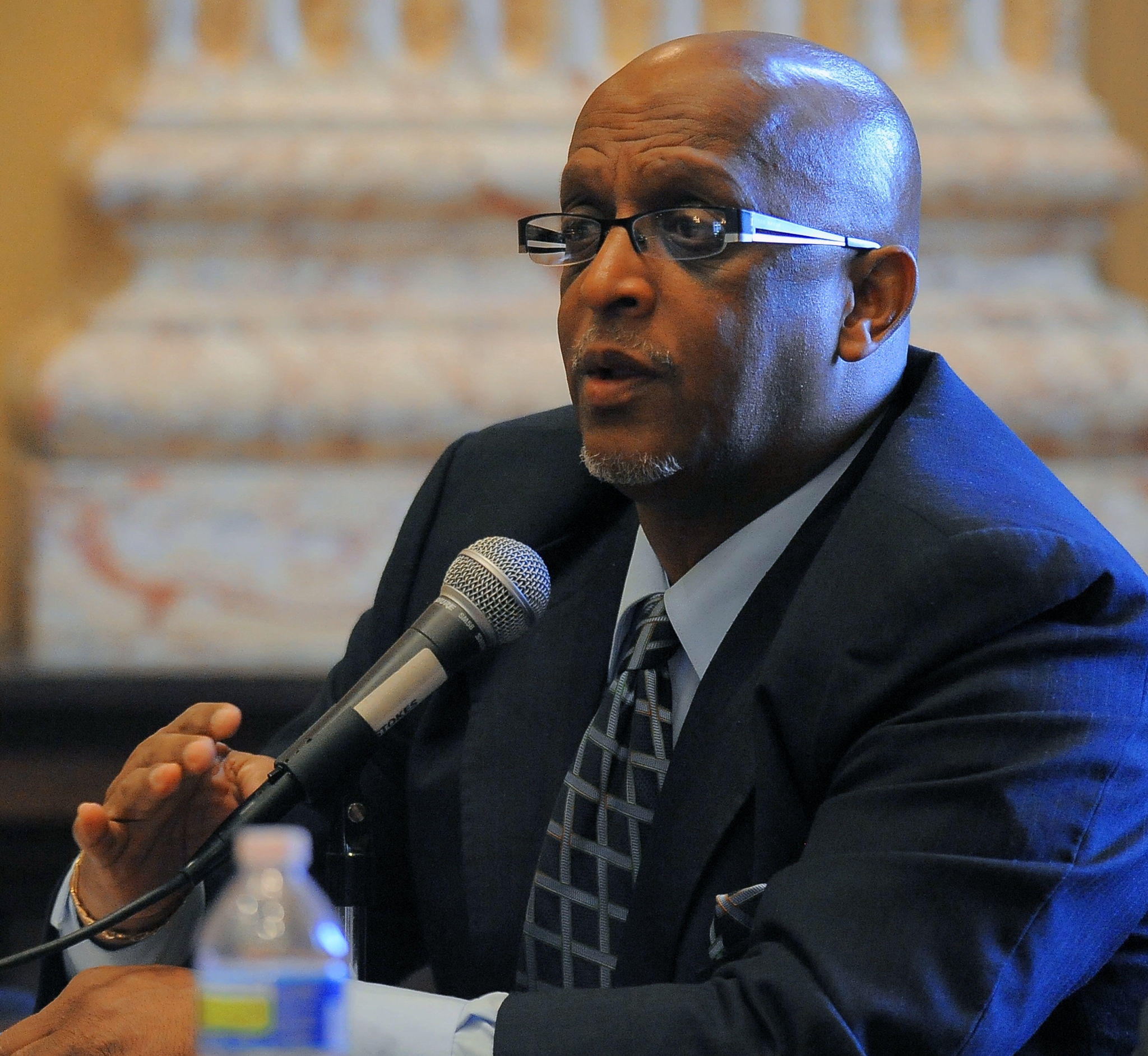 "Baltimore City Council President Bernard C. ""Jack"" Young speaks to police officials during a hearing at City Hall hours following a triple homicide March 19, 2013."