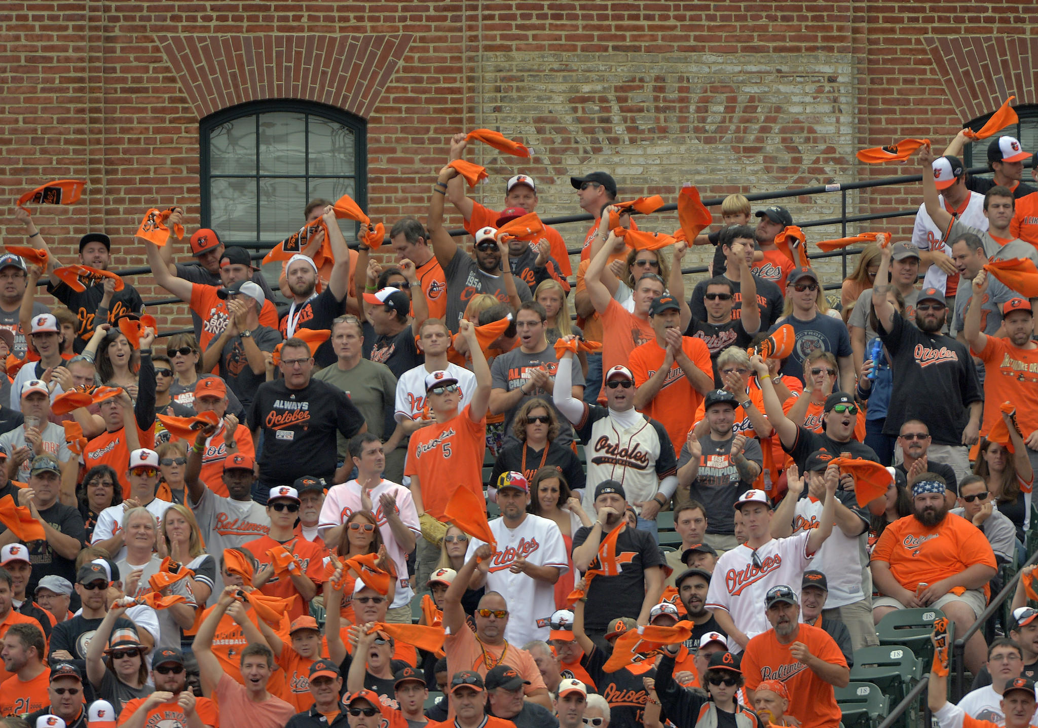 The warehouse provides a backdrop as fans cheer the Baltimore Orioles at game two of the ALDS at Oriole Park at Camden Yards.