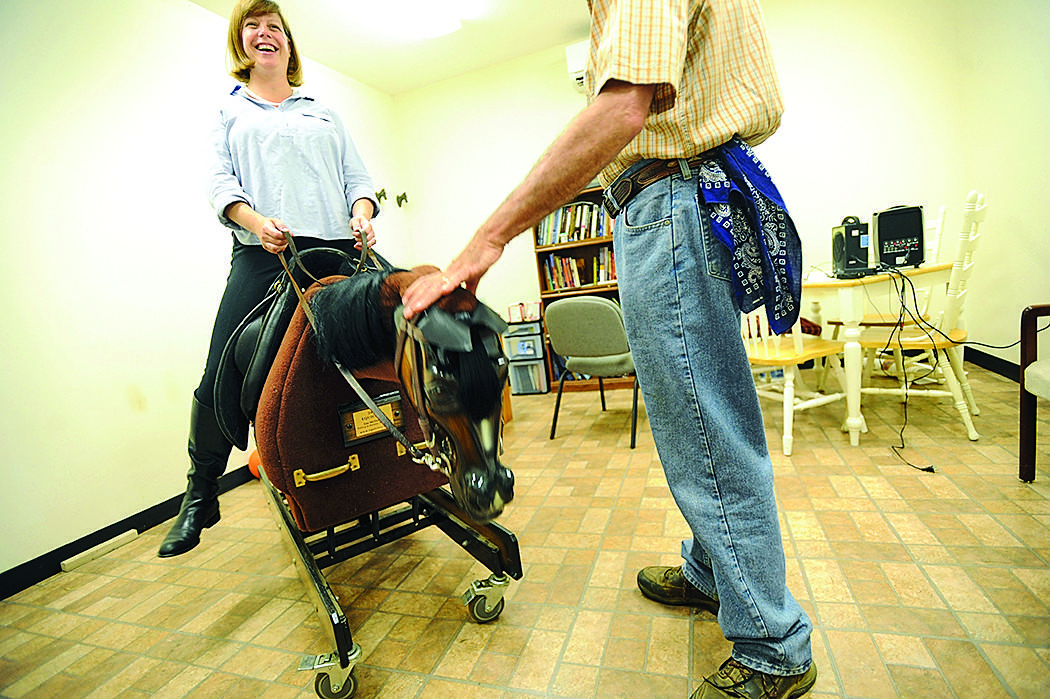 Kit Pollard practices on a mechanical horse to learn the basics to start her horseback riding lesson at Graham Equestrian Center in Glen Arm.