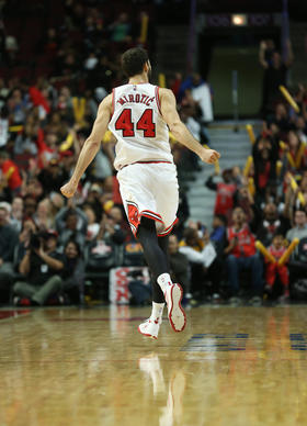 Nikola Mirotic runs down the court after hitting a three-point basket in the fourth quarter.