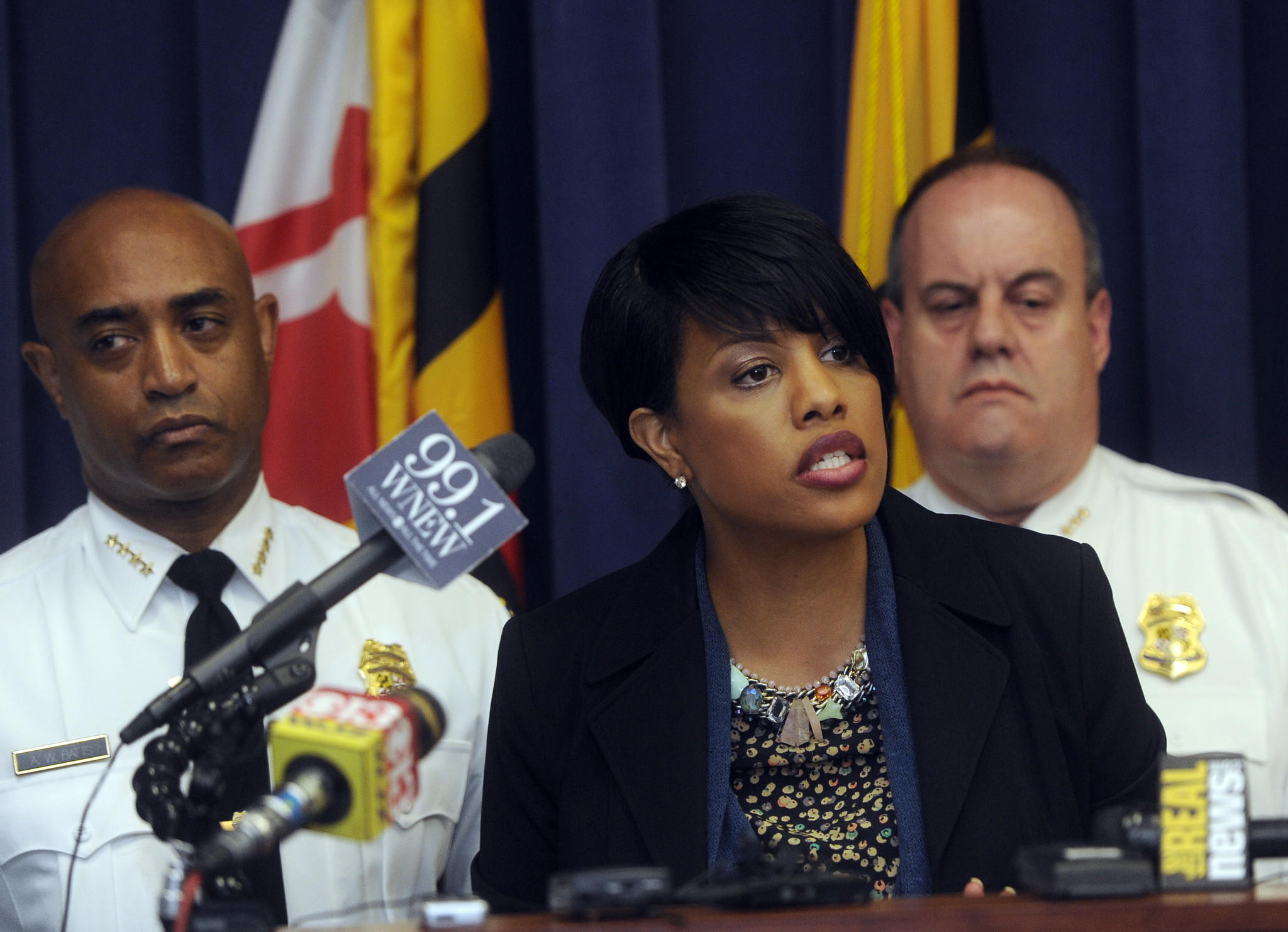 Baltimore Mayor Stephanie Rawlings-Blake, joined by Baltimore Police Commissioner Anthony Batts, left, discusses a report which outlines steps the city plans to take to reduce police brutality.