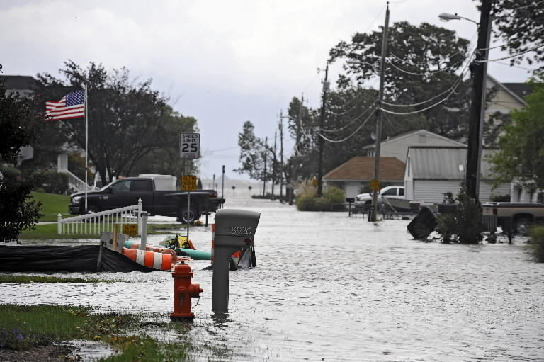 Low-lying waterfront communities like Miller's Island in Baltimore County are predicted to get flooded more often in years ahead as seas rise.