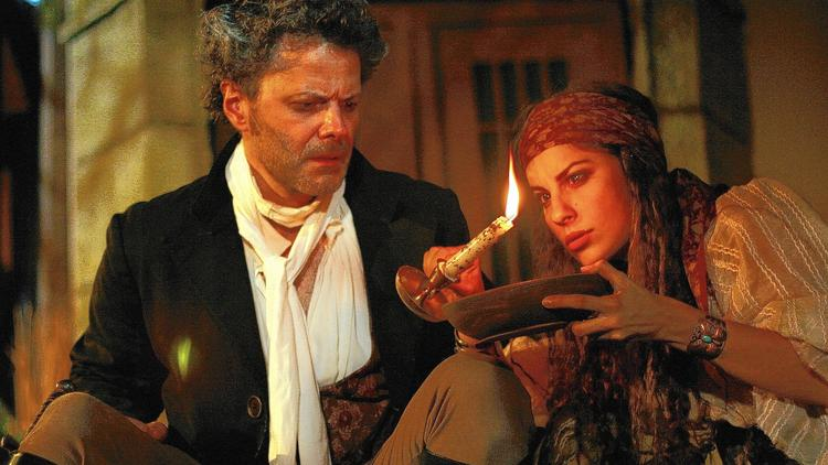"""Doug MacKechnie and Simina Contras in """"The Gravedigger."""""""