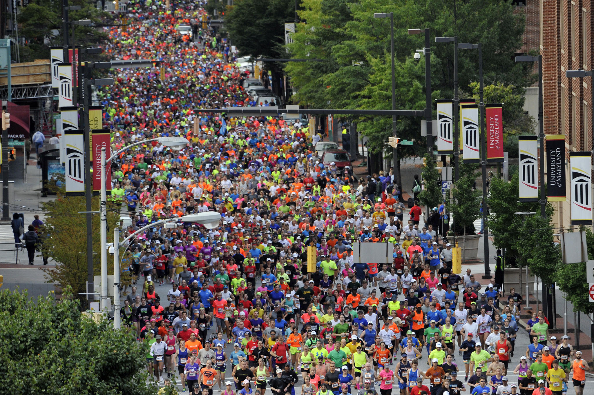 Runners begin the Baltimore Running Festival on Paca Street.