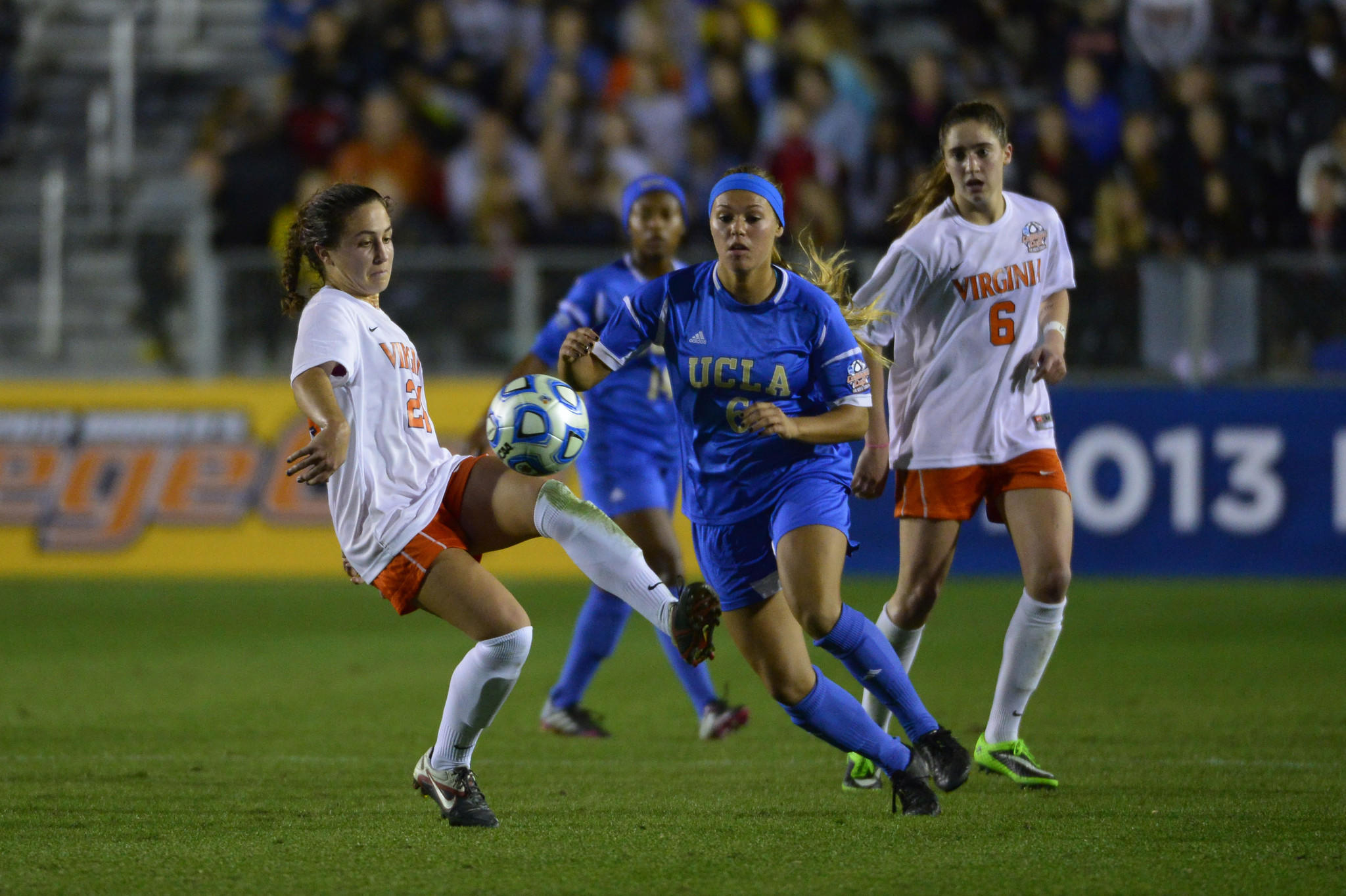 Virginia midfielder Danielle Colaprico, left, kicks the ball as midfielder Morgan Brian, right, watches against UCLA in December in Cary, N.C.
