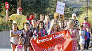 Students hoof it to class as part of International Walk to School Day
