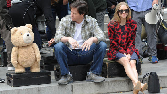 """Actor Mark Wahlberg and Amanda Seyfried are seen on the set of """"Ted 2"""" on Oct. 7, 2014, in New York City with Ted (the bear is voiced by Seth MacFarlane)."""