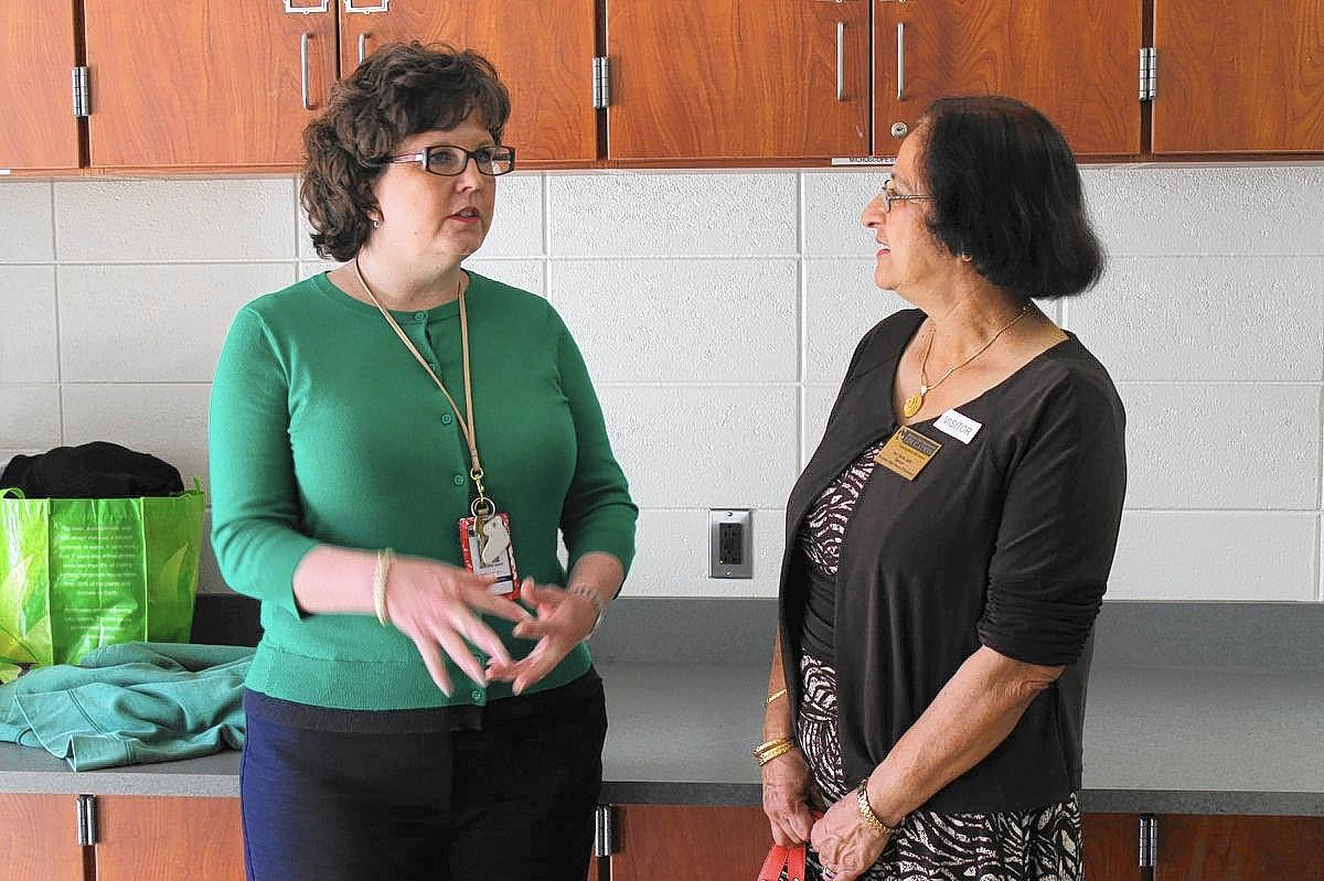 Beth Burke (left), assistant principal at Folger McKinsey Elementary School, answers questions from Madhu Sidhu, a member of the Maryland Board of Education, during a tour of the school Wednesday. State and federal officials visited the school to learn about its environmental education efforts.
