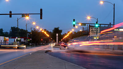 Cars move through the intersection of 119th and Halsted Streets in Chicago.