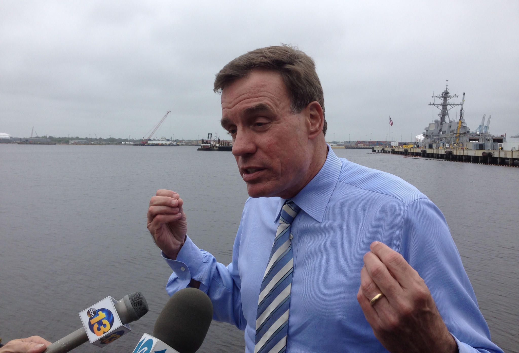 In this file photo, Sen. Mark R. Warner speaks to reporters at a campaign stop in Norfolk about his decision to call for the resignation of Veterans Affairs Secretary Eric Shinseki.