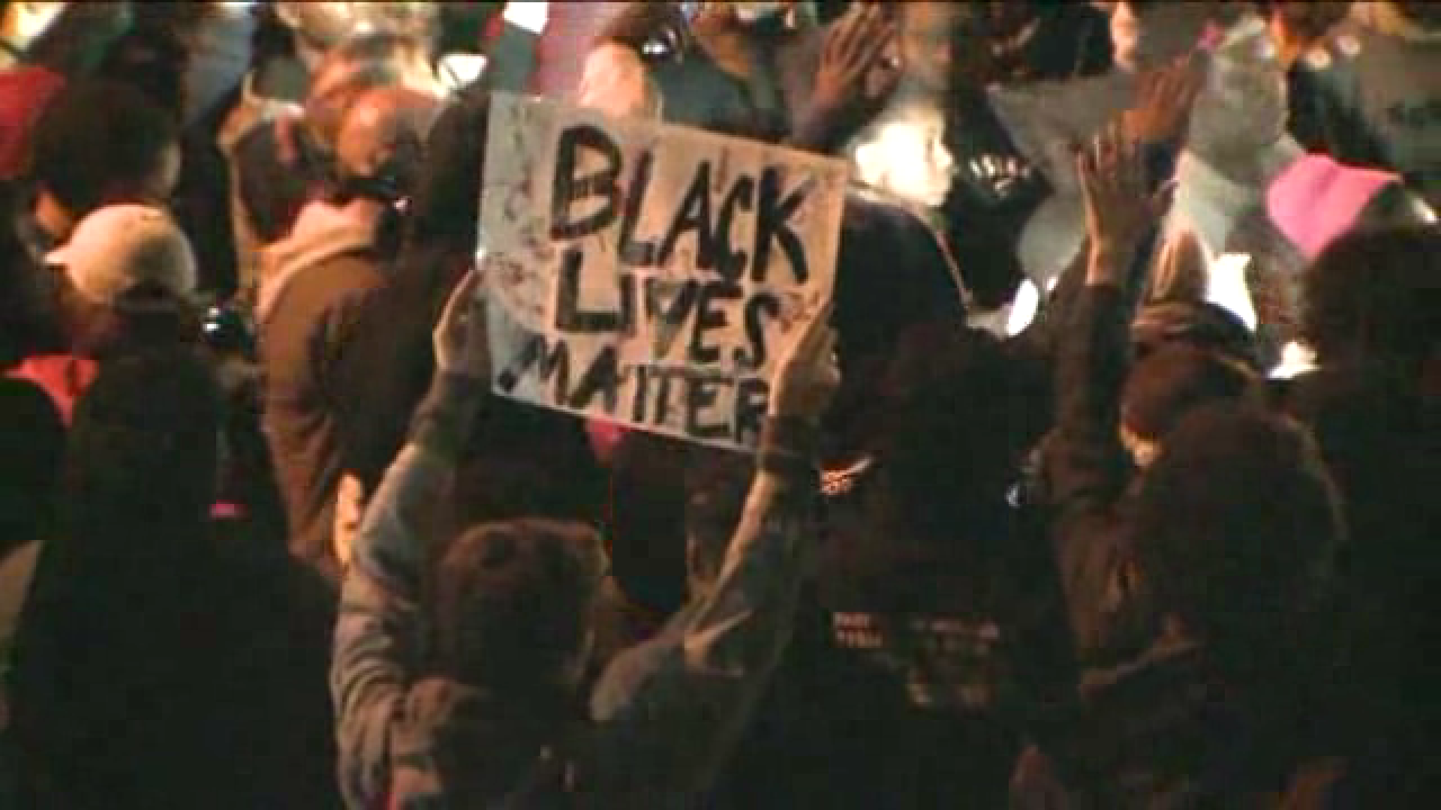 Michael Brown protesters hold vigil and march to Ferguson PD ...
