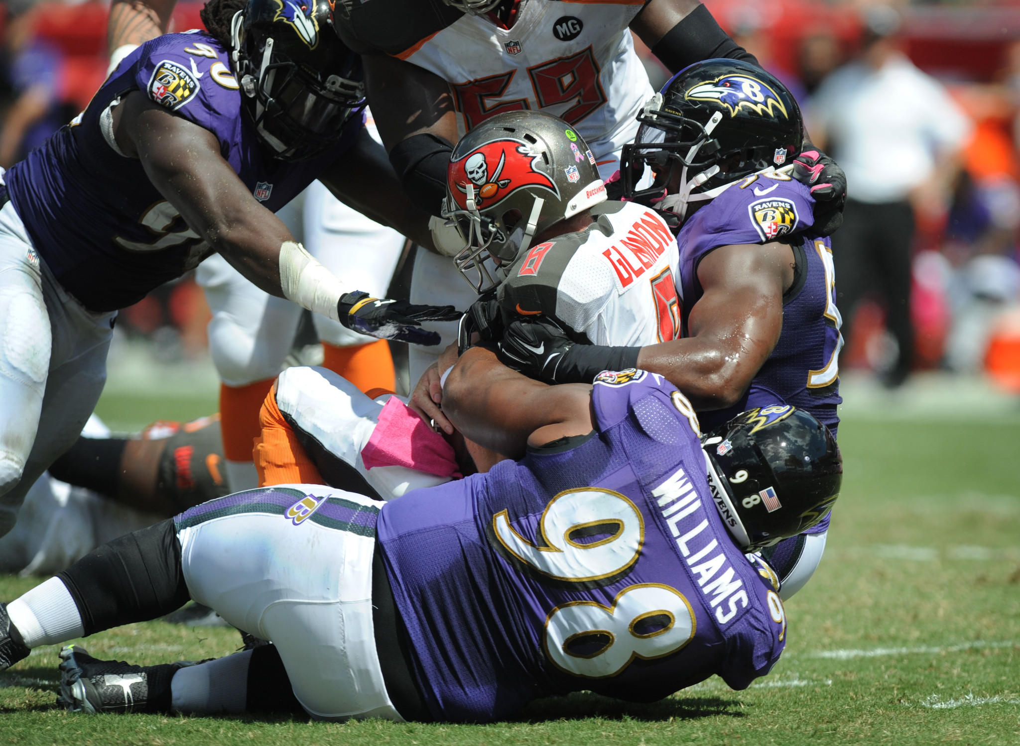Tampa Bay Buccaneers Mike Glennon is sacked by Ravens linebacker Pernell McPhee, defensive end Brandon Williams and outside linebacker Elvis Dumervil.