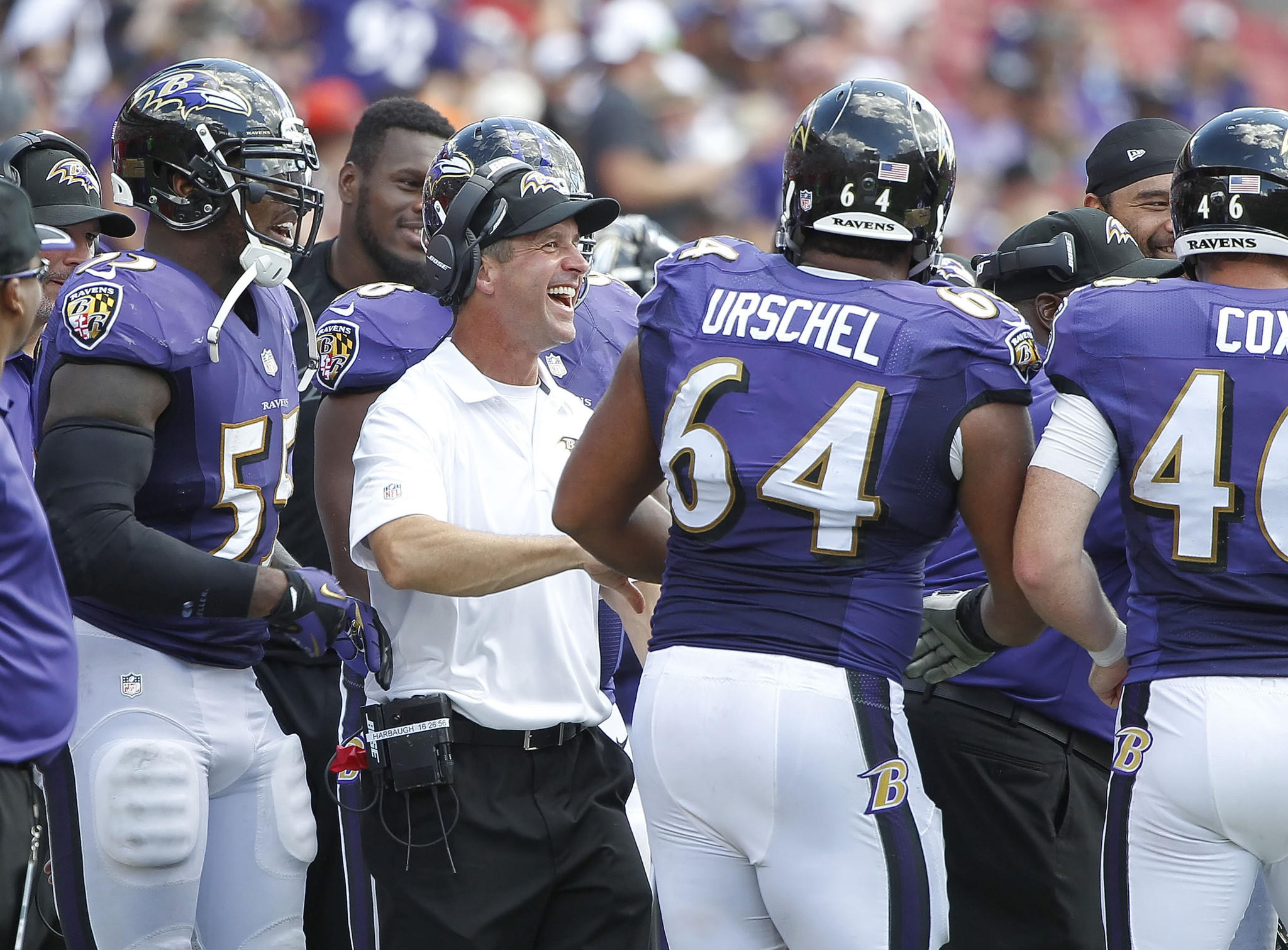 Ravens head coach John Harbaugh laughs with guard John Urschel after scoring against the Tampa Bay Buccaneers during the second half at Raymond James Stadium.